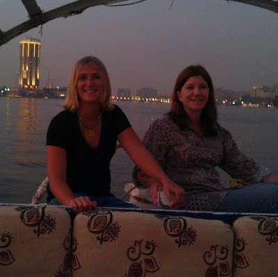 Mother Daughter posing together on a felucca boat on the Nile in Cairo Egypt
