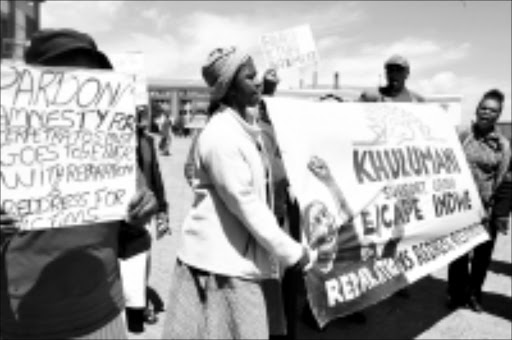 DISSATISFIED: Supporters of victims of political violence demonstrate outside the Constitutional Court yesterday. Pic: Mohau Mofokeng. 10/11/2009. © Sowetan.