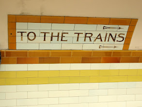 "Photo: Tube train sign ""To the Trains"", on tiles"