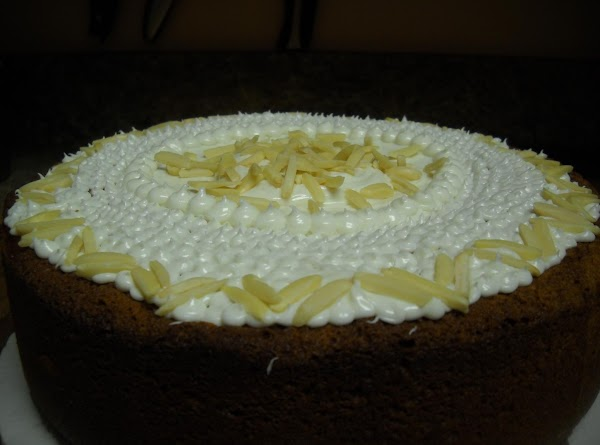 Once cake is completely cooled, frost with white topping as desired. I chose to...
