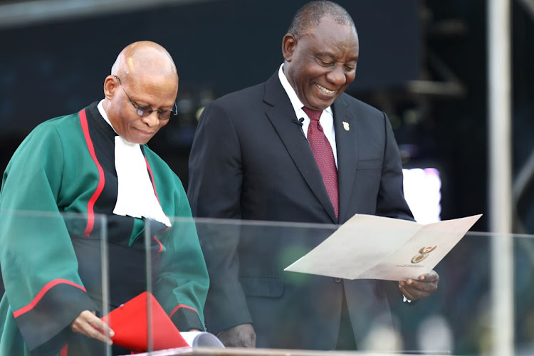 A joyous moment between President Cyril Ramaphosa and Chief Justice Mogoeng Mogoeng during Ramaphosa's inauguration at Loftus Versfeld stadium in Pretoria on 25 May 2019.