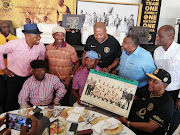 Kaizer Chiefs chairman Kaizer Motaung (wearing a cap) with the club's officials and former players including politician UDM leader Bantu Holomisa in Soweto on January 7 2020.