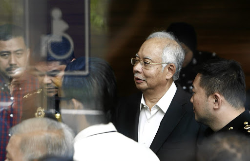 Probing questions: Malaysia's former prime minister Najib Razak arrives to give a statement to the Malaysian anticorruption commission in Putrajaya on Thursday. Picture: REUTERS