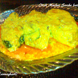 Ilish Macher Sorshe bata diye Jhal ( Hilsa Fish in Mustard Gravy ).