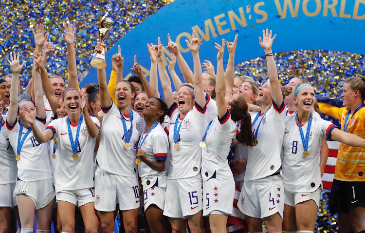The US women's soccer team celebrate after beating the Netherlands 2-0 to win the Fifa Women's World Cup in France on July 7 2019.