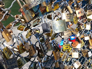 Photo: Pont des Arts -Famous for lovers' locks today, originally famous for being the first iron bridge in Paris. By the way, officials now remove the locks, because too many weigh down the bridge and are a very real safety hazard.