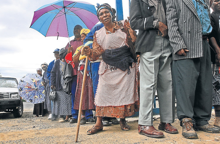 Social grant beneficiaries queue in Sterkspruit in the Eastern Cape. Picture: DAILY DISPATCH
