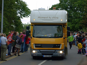 Photo: All looks suddenly turn to glance behind lorry to catch a glimpse of the Olympic flame runner on Mill Road - Cambridge 2012