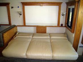 "Photo: Sofa ""scissors"" to create additional sleeping space."