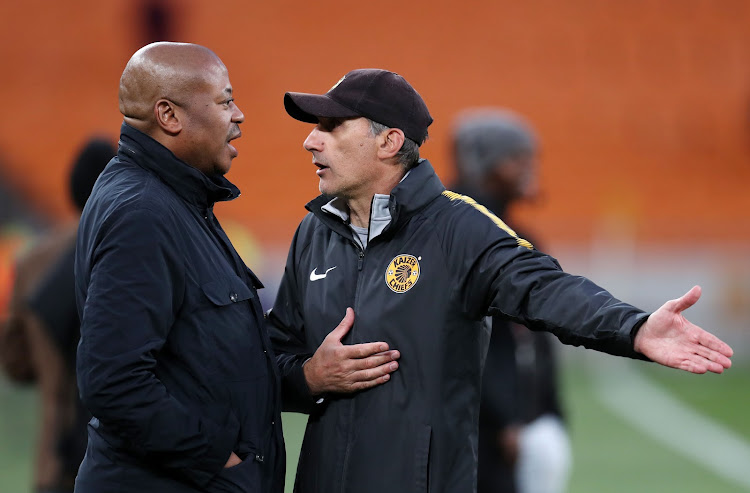 Kaizer Chiefs Football Manager Bobby Motaung in a discussion with head coach Giovanni Solinas during the Telkom Knockout match against Black Leopards at the FNB Stadium in Johannesburg on October 21, 2018.