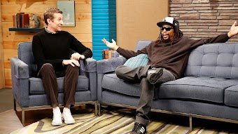 Lil Jon Wears a Baseball Cap and Sunglasses