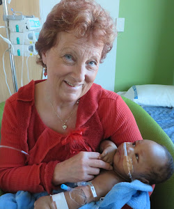 D9710 Chair Sandra Malhberg with Baby Fitz from the Solomon Islands