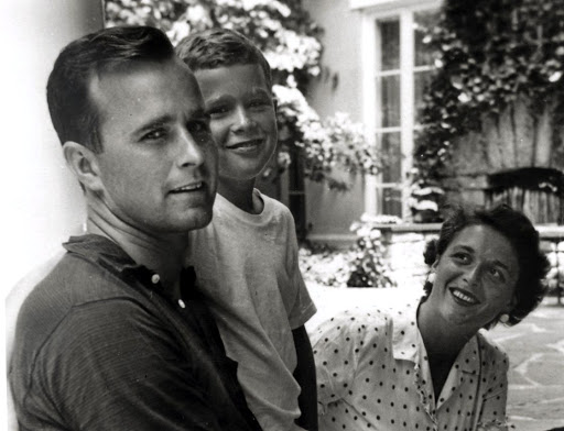 Barbara Bush with two future US presidents — her husband, George HW Bush, and son George W Bush, in Rye, New York, in this photo taken during the summer of 1955. Picture: HANDOUT VIA REUTERS