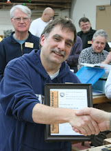 Photo: Tim Aley receives MCW Certificate of Appreciation for his work on the Celebrate 25 entry, as Secretary, as the candid photographer, and as a demonstrator at the Renwick and the Woodworkers Club.