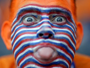 Photo: A Dutch supporter, his face painted in the colors of the national flag, sticks his tongue out as he waits for the start of the group C match between the Netherlands and Italy in Bern, Switzerland, Monday, June 9, 2008, at the Euro 2008 European Soccer Championships in Austria and Switzerland. (AP Photo/Dusan Vranic)