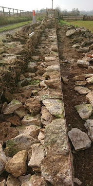 Cotswold Dry Stone wall foundations being laid in Tetbury, Gloucestershire