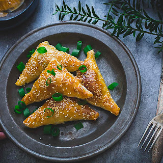 Five-Spice Pork and Onion Pastry Triangles.