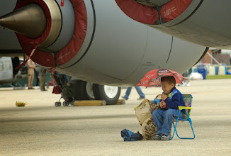 Photo: A young bog shields himself from the chilly winds as he watches the US Air Force Thunderbirds perform during the 2009 Joint Service Open House at Andrews Air Force Base on May 17, 2009. The JSOH allows members of the public an excellent opportunity to meet and interact with the men and women of the Armed Forces.  (U.S. Air Force photo by Senior Airman Renae L. Kleckner)(released)