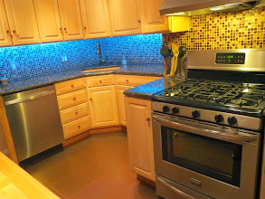 Photo: kitchen with granite countertops and stainless appliances