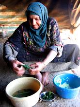Photo: Hajja Khalil, making grape leaf rice rolls
