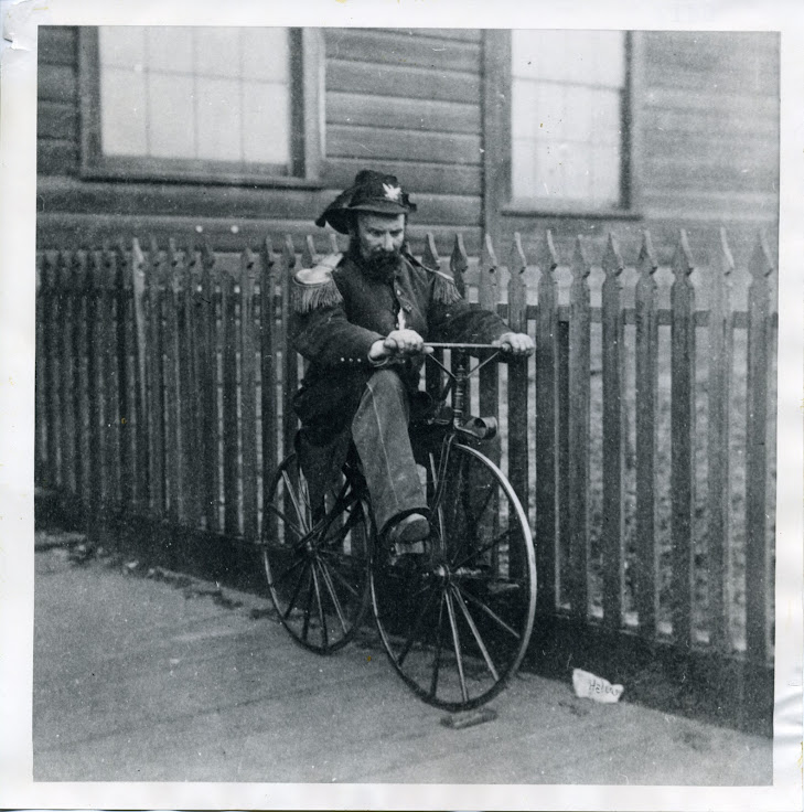 Emperor Norton I on a bicycle.