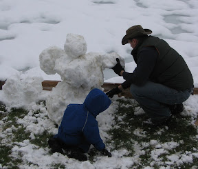 BigE and Dadda working on the snowman