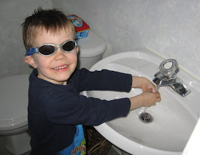 BigE with sunglasses on washing his hands