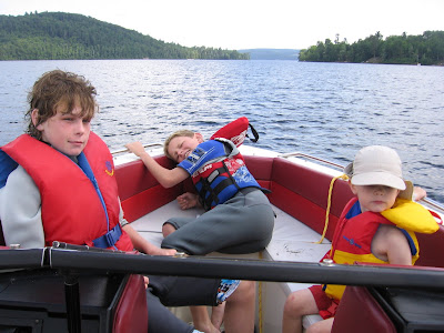 Kids in the bow of the boat