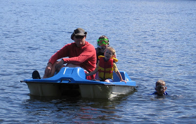 BigE and Dada in a pedal boat