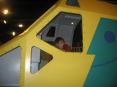 BigE in the pilot seat of a helicopter mockup