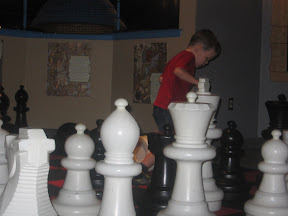 BigE playing with large chess peices