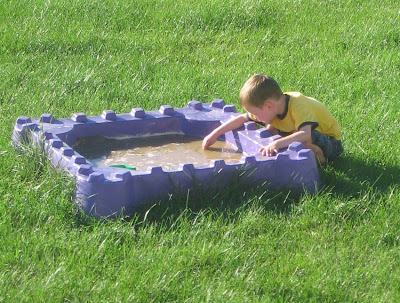 BigE playing in the flooded sandbox