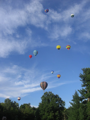 Hot air balloons floating away