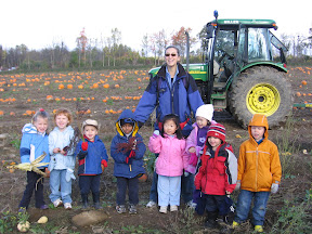BigE out in the pumpkin patch with his teacher