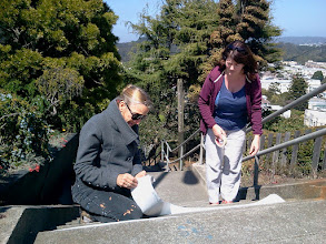 Photo: Project artists Colette Crutcher (left) and Aileen Barr taking the first measurements of the Hidden Garden Steps (16th Avenue, between Kirkham and Lawton streets in San Francisco's Inner Sunset District) to begin preparing a full-scale illustration of the ceramic-tiled step mosaic design in September 2012.For more information about the project, please visit http://hiddengardensteps.org.