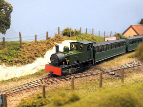 """Photo: 012 Ryedown Lane has become a well known and very popular 009 layout inspired by the Colonel Stephens' light railways and an excellent example of the """"keep it simple"""" school of modelling. A passenger train in the charge of ex-Snailbeach Railway large Bagnall """"Dennis"""", about to leave Winterbourne Road in this view ."""