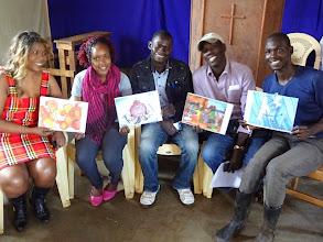 Photo: Lindi-Pesa group looking at their community currencies artwork.