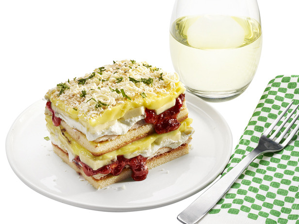 """Photo: April Fools' Lasagna: Banana Pudding Cake: There are no noodles in this """"lasagna"""", just layers of pound cake, vanilla pudding, bananas and strawberry jam. Shaved white chocolate, crushed vanilla wafers and chopped mint leaves make up the """"cheesy"""" topping. Get this recipe>> http://ow.ly/9ZU9n"""
