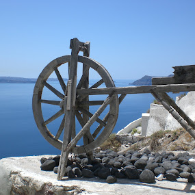 The Wheel by Amanda Dacey - Travel Locations Landmarks ( wheel, greece, sea, view, oia, cyclades, santorini )