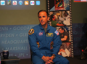 Photo: I'd give you Joe's entire resume, but it would break the Internetz. Suffice to say, he is an accomplished mission specialist, geologist, and teacher... as well as a Shuttle, Soyuz, and ISS veteran!  Here he is giving his talk while we were live on NASA TV! :)