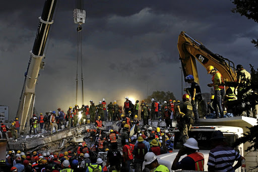 Rescue workers and Mexican soldiers take part in a rescue operation at a collapsed building in the Obrera neighbourhood in Mexico City, after an earthquake, on September 20 2017. Picture: REUTERS