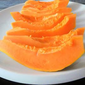 The ripe orange papaya by Svetlana Saenkova - Food & Drink Fruits & Vegetables ( papaya, orange, fruit, tasty, fresh,  )