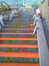 Photo: View of top two flights of steps of the Hidden Garden Steps (16th Avenue, between Kirkham and Lawton streets in San Francisco's Inner Sunset District) as KZ Tile workers finished installing more than 50 pieces of the 148-step ceramic-tile mosaic designed and created by project artists Aileen Barr and Colette Crutcher. Tread tiles are stacked on each side in anticipation of installation. For more information about this volunteer-driven community-based project supported by the San Francisco Parks Alliance, the San Francisco Department of Public Works Street Parks Program, and hundreds of individual donors, please visit our website at http://hiddengardensteps.org.
