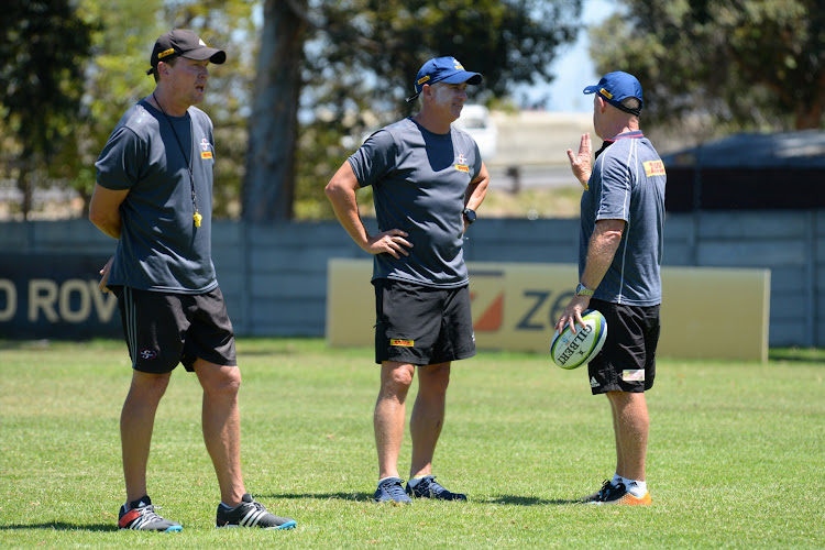 The DHL Stormers forwards coach Russell Winter (L) head coach Robbie Fleck (C) and skills coach Paul Feeney (R) during a training session on February 6 2019.