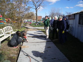 Photo: How many Sebagoites does it take to fix a walkway? One big task for the day - put the walkway back in place. Made of recycled PVC lumber, the entire path had floated, breaking into pieces of various sizes as it moved. The bigger chunks had to be sawed apart to allow us to move them.