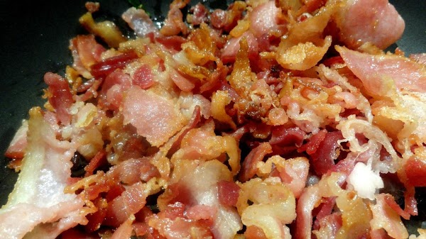 In a large, deep skillet, fry the chopped bacon until brown, and reserve 2...