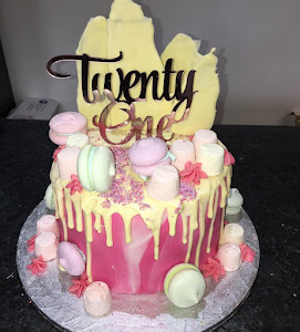 Pink marble and white chocolate drip cake
