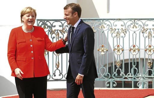 German Chancellor Angela Merkel welcomes French President Emmanuel Macron to the German government guesthouse in Meseberg on June 19 2018. Picture: REUTERS