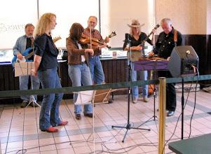 Photo: Red Dirt Road: Al Burgasser (bass), Missy Alexander, Susie Marker (fiddle), Bill Petkanus (mando), Pat Walker, Doug Mathewson Photo by Fred Robbins