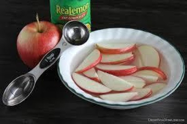 Place apple slices in a medium bowl. Cover with cold water and add a...